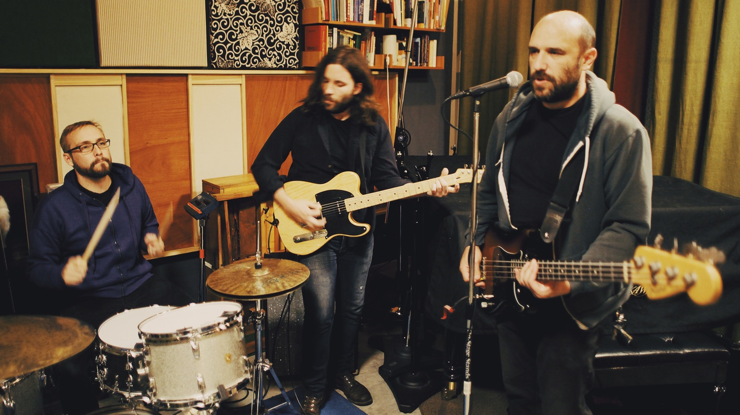 """Remember being a kid and wanting a bike so bad you pleaded with Santa? Well, David Bazan, frontman for Pedro The Lion, encapsulates a core ache he's been exploring for many Christmases on """"Yellow Bike."""""""