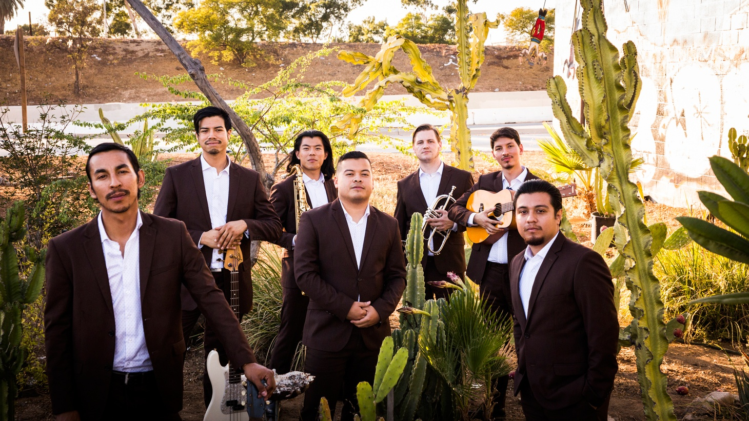 "Emerging East LA outfit The Delirians add a lot of flavor to their blend of traditional ska and reggae. The guys are excited about their brand new recording out early summer, which features ""Give A Little Bit."""