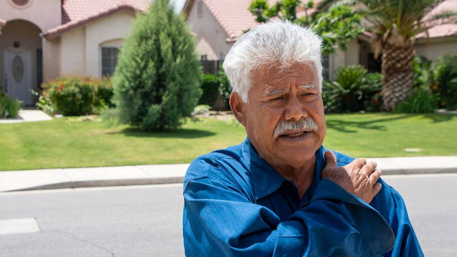 Arturo Gonzalez stands outside his home in Bakersfield, California. Gonzalez settled with the city of Bakersfield for injuries he received after officers struck him in January 2015.