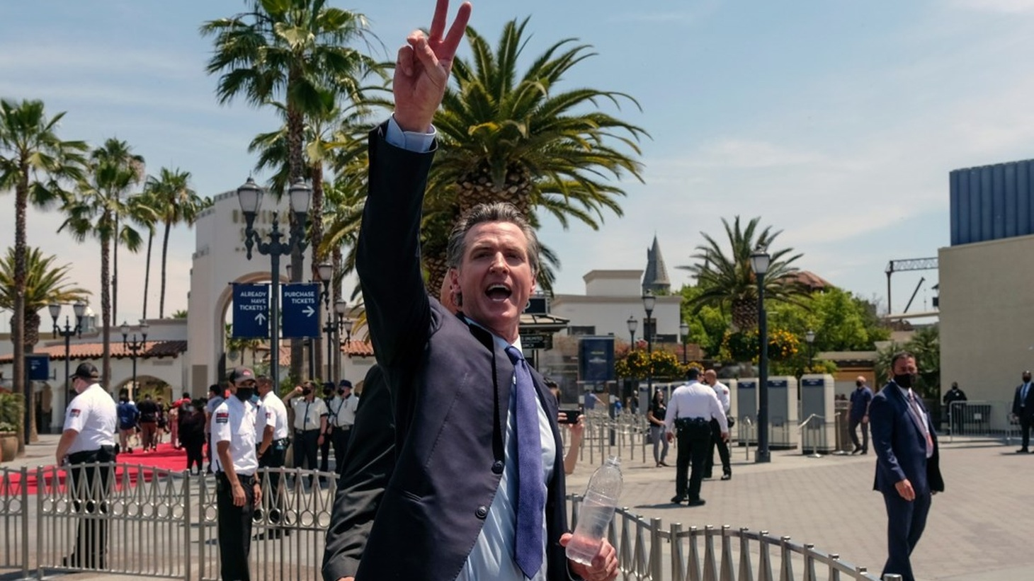 In this June 15, 2021 file photo California Governor Gavin Newsom gestures after a news conference at Universal Studios in Universal City, Calif.