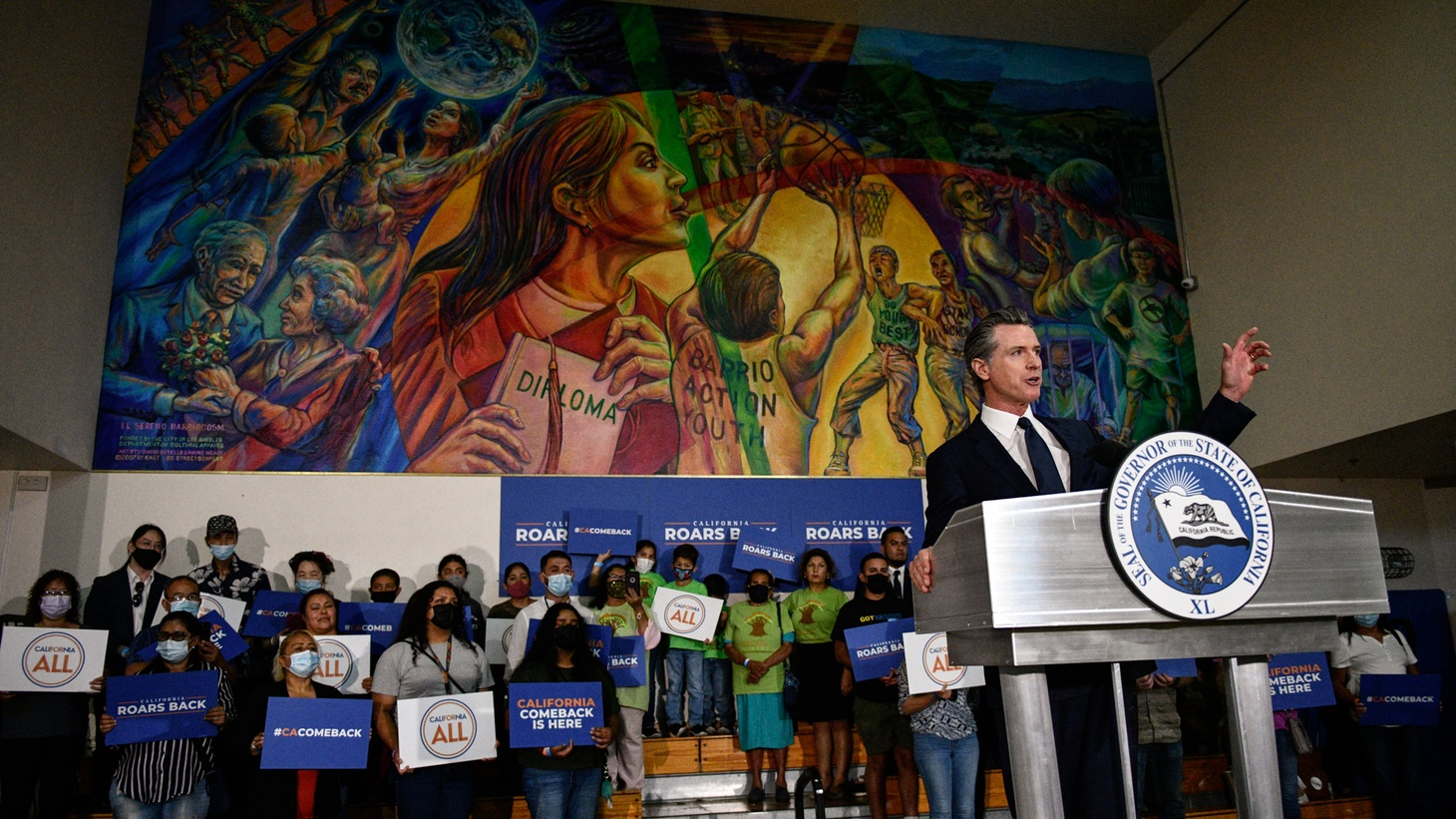 Gov. Gavin Newsom delivers a speech during a rally at the Barrio Action Youth and Family Center in El Sereno, where he signed the California Comeback Plan relief bill, on July 13, 2021.