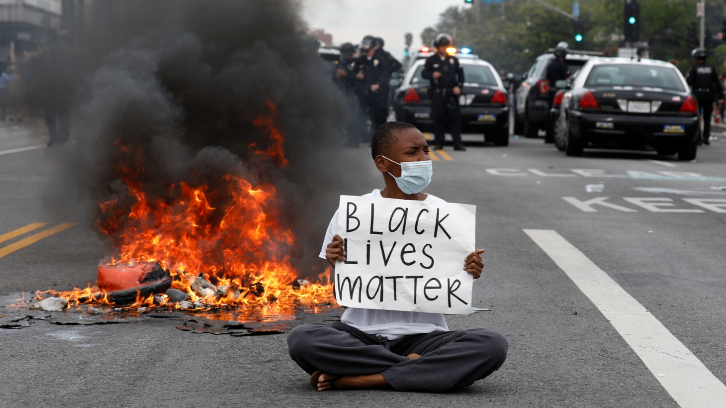 A demonstrator holds a placard during a protest against the death in Minneapolis police custody of George Floyd, in Los Angeles, May 30, 2020.