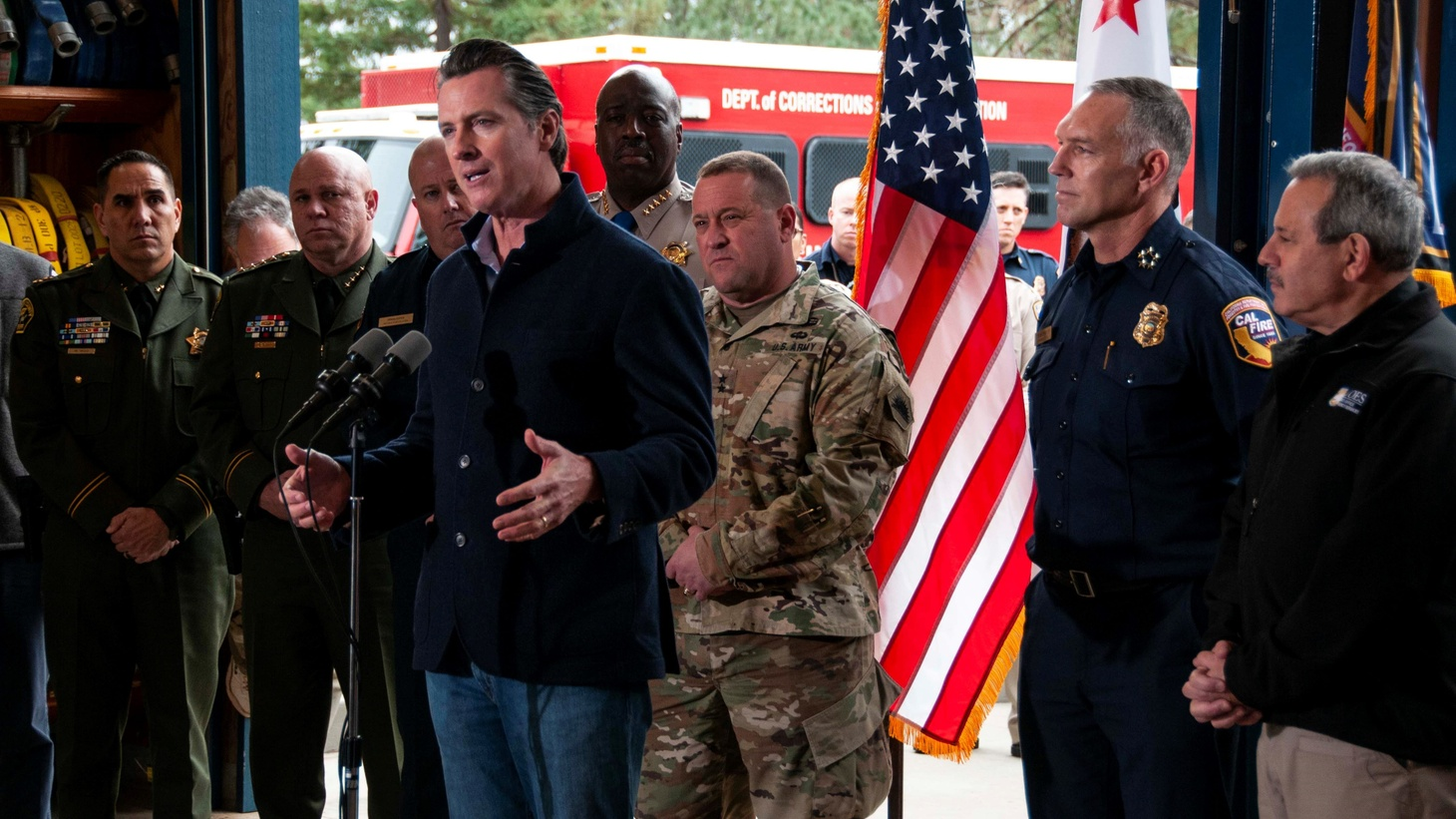 Gov. Gavin Newsom holds a press conference on wildfires on his first full day in office, January 8, 2019, flanked by emergency responders and local officials.