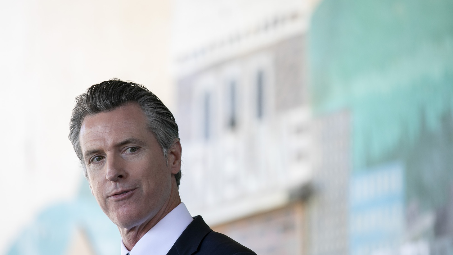 Gov. Gavin Newsom, facing a recall, prepares to speak at a press conference to announce a new requirement for all school teachers and employees to show proof of vaccination or to undergo weekly COVID-19 testing, at Carl B. Munck Elementary School in Oakland on Aug. 11, 2021.