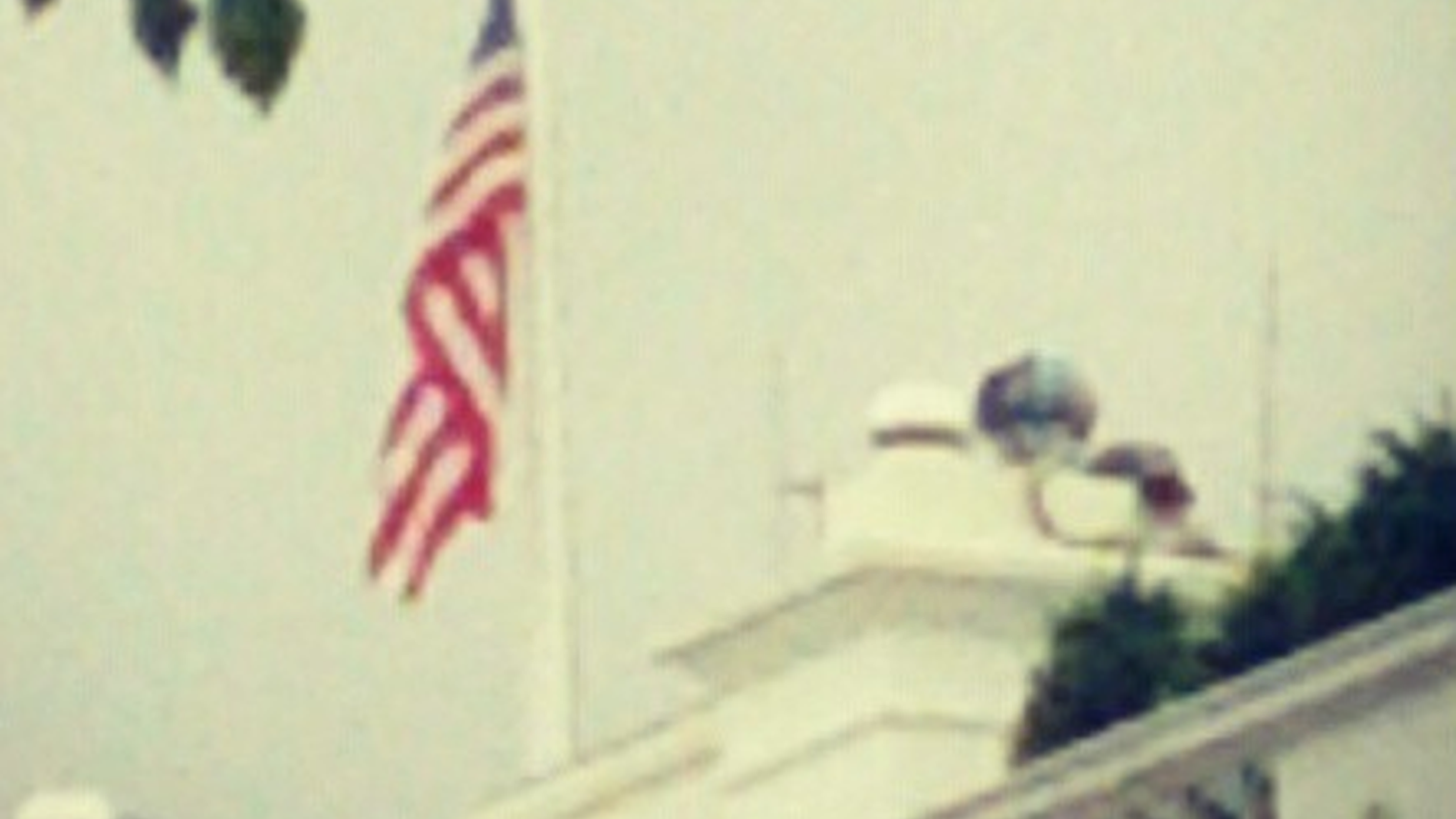 @JaredRizzi tweeted this photo of the flag atop the White House at half mast