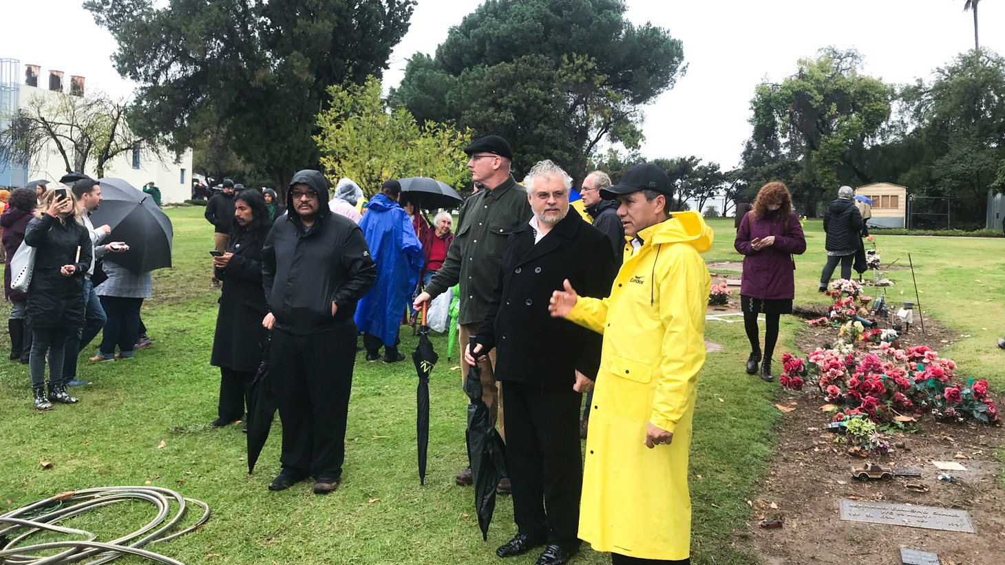 In spite of the rain, more than 100 people attended a memorial service at LA County Crematorium and Cemetery.
