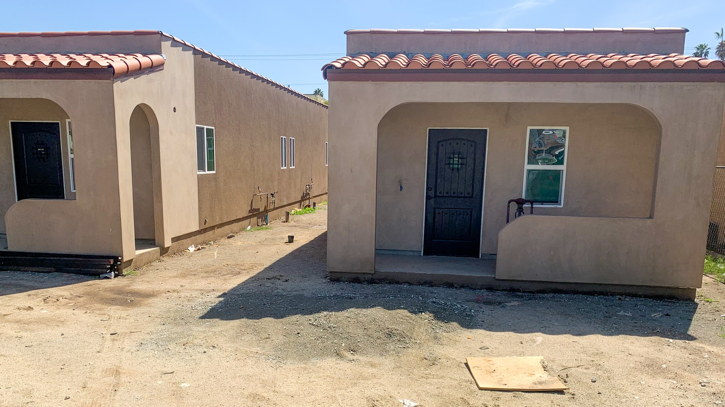This eight-unit bungalow court project in the Vermont Knolls neighborhood will house formerly homeless tenants when it's finished in May. The cost to build it is roughly half of what a typical affordable housing development costs.
