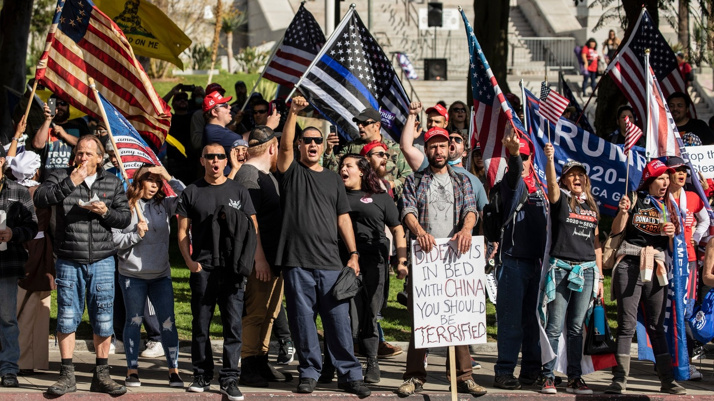 Unmasked Trump supporters brought signs and flags to a rally in downtown LA on Jan. 6, 2021, the day insurrectionists stormed the U.S. Capitol.