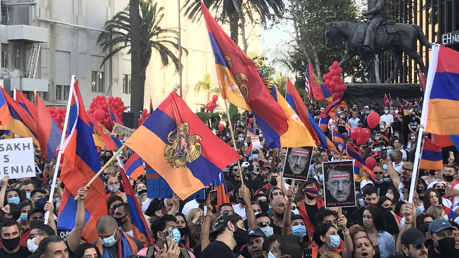 Protesters waving flags of Armenia and the self-proclaimed Republic of Artsakh during a rally near the Turkish consulate in Beverly Hills on October 11, 2020.