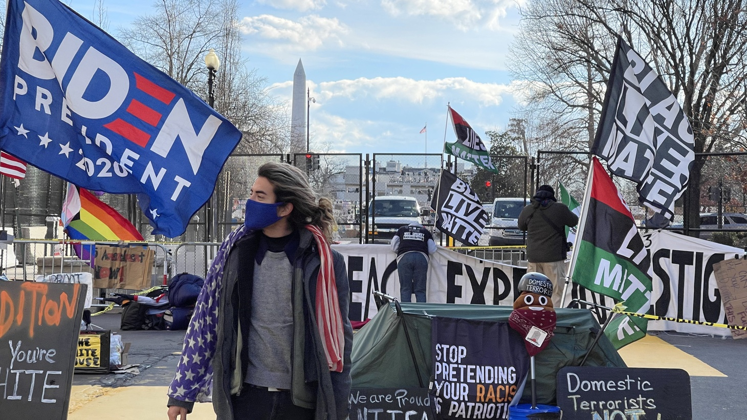 """""""I got my American flag scarf that had been accumulating dust for the last couple of years, and I want to reclaim it as a symbol of hope, as a symbol of inclusivity and diversity,"""" says Edwin Rivera, standing in Black Lives Matter Plaza in Washington, D.C."""