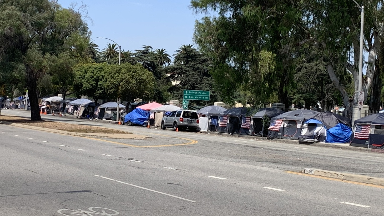 Right outside the West LA VA, there are more than two dozen identical tents with matching American flags pinned to the outside.