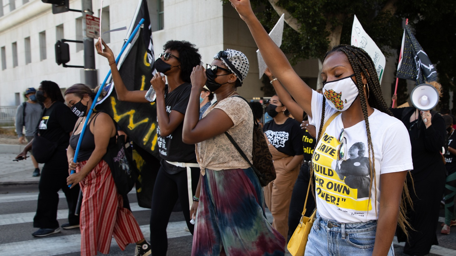 """Demonstrators march the streets of downtown Los Angeles chanting, """"Say his name, George Floyd,"""" May 25, 2021."""