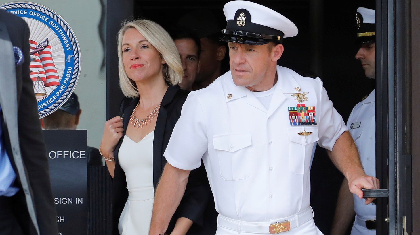 U.S. Navy SEAL Special Operations Chief Edward Gallagher (R), with wife Andrea Gallagher, leaves court after being acquitted of most of the serious charges against him during his court-martial trial at Naval Base San Diego in San Diego, California , U.S., July 2, 2019.