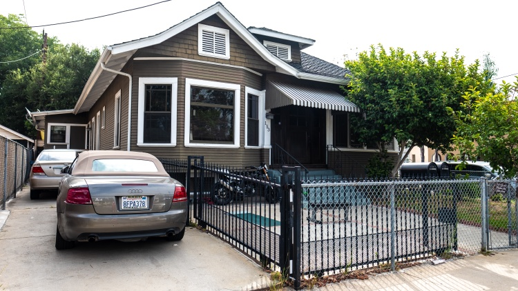 Until last month, Helen Harlan lived in a five-bedroom house in Highland Park with 24 roommates.