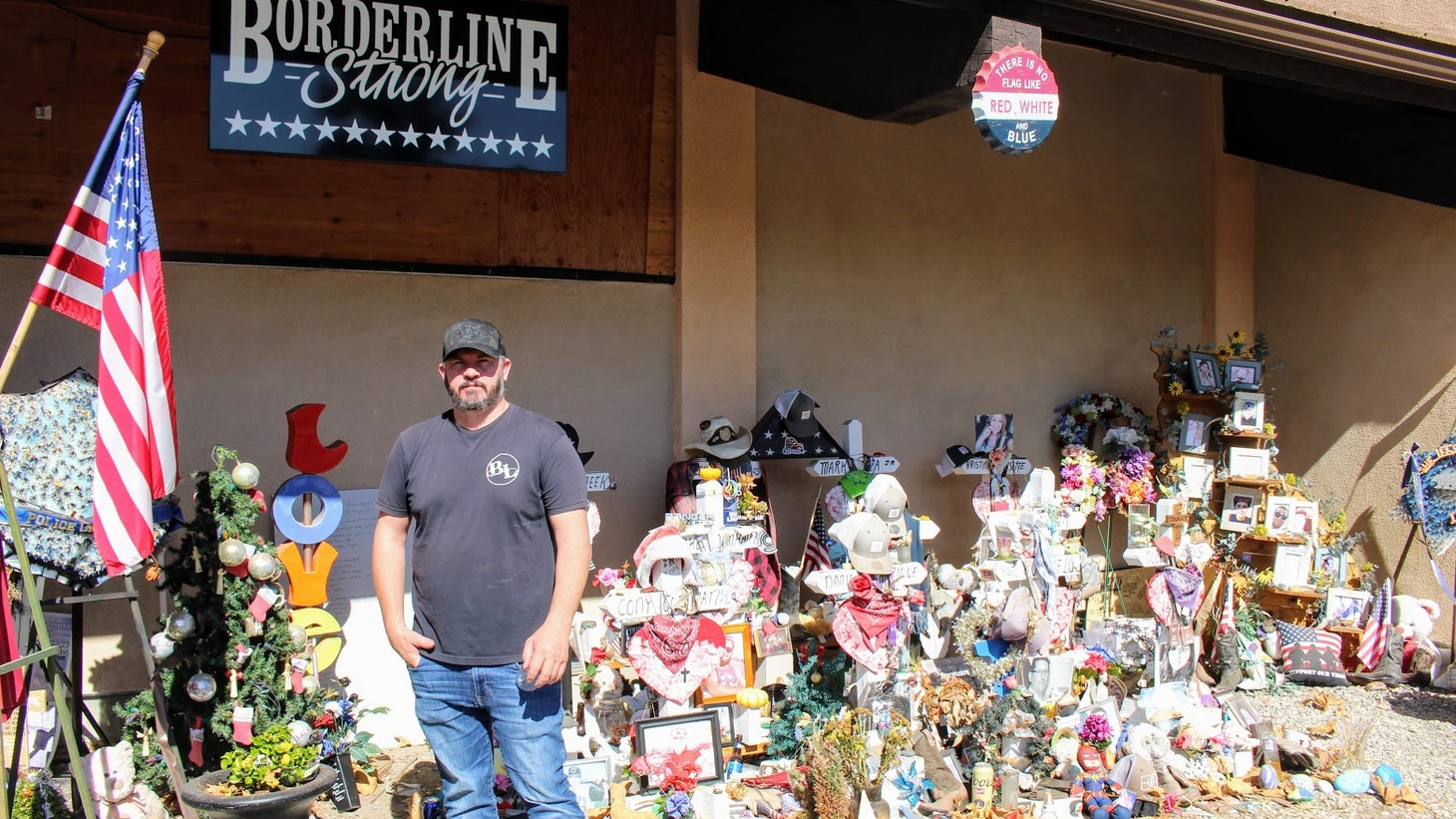Borderline owner Brian Hynes stands in front of a memorial outside Borderline Bar in Thousand Oaks.