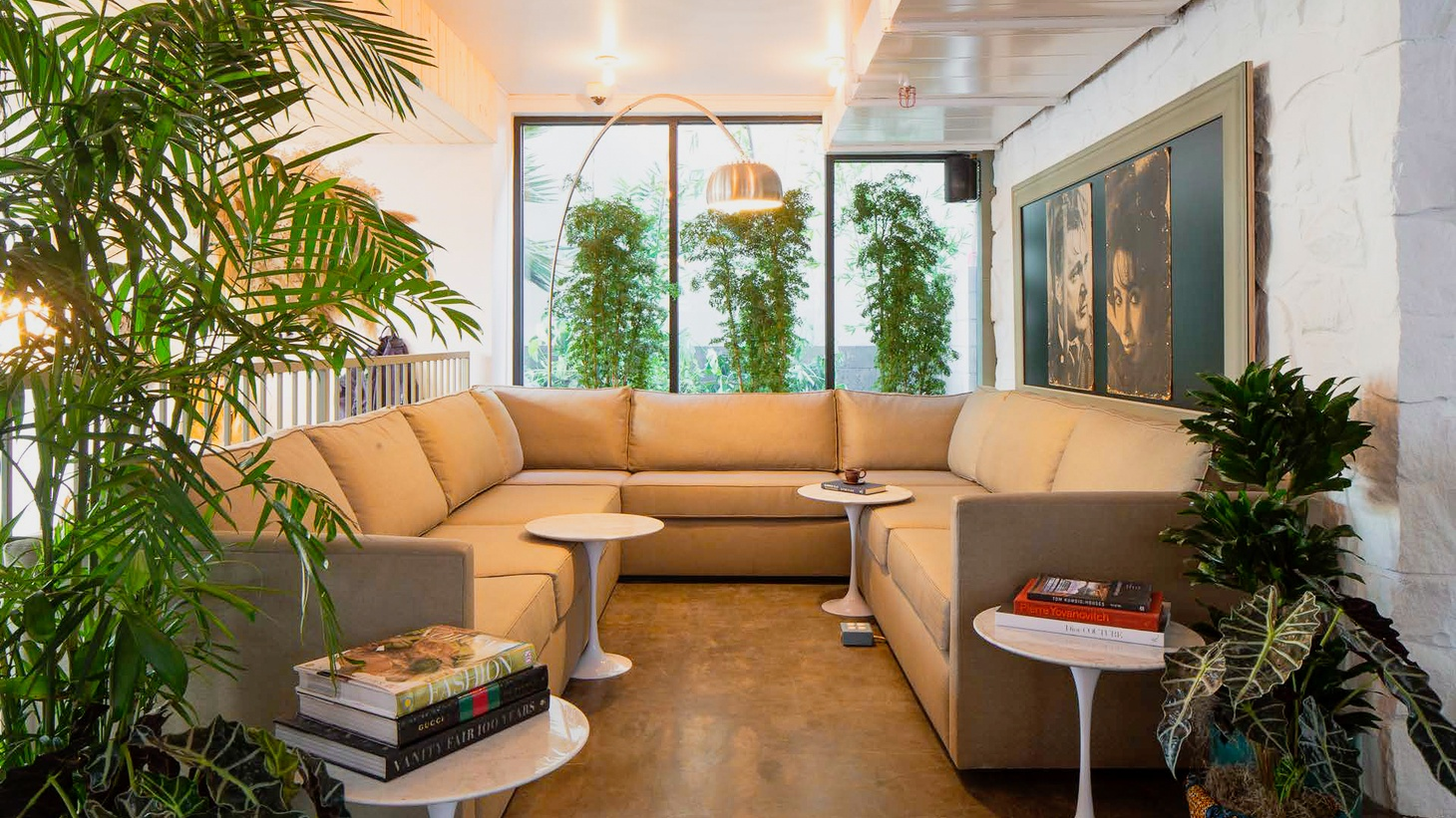 Treehouse is a five-story, fully furnished co-living building in Hollywood. It includes a coffee shop with seated areas like this one.