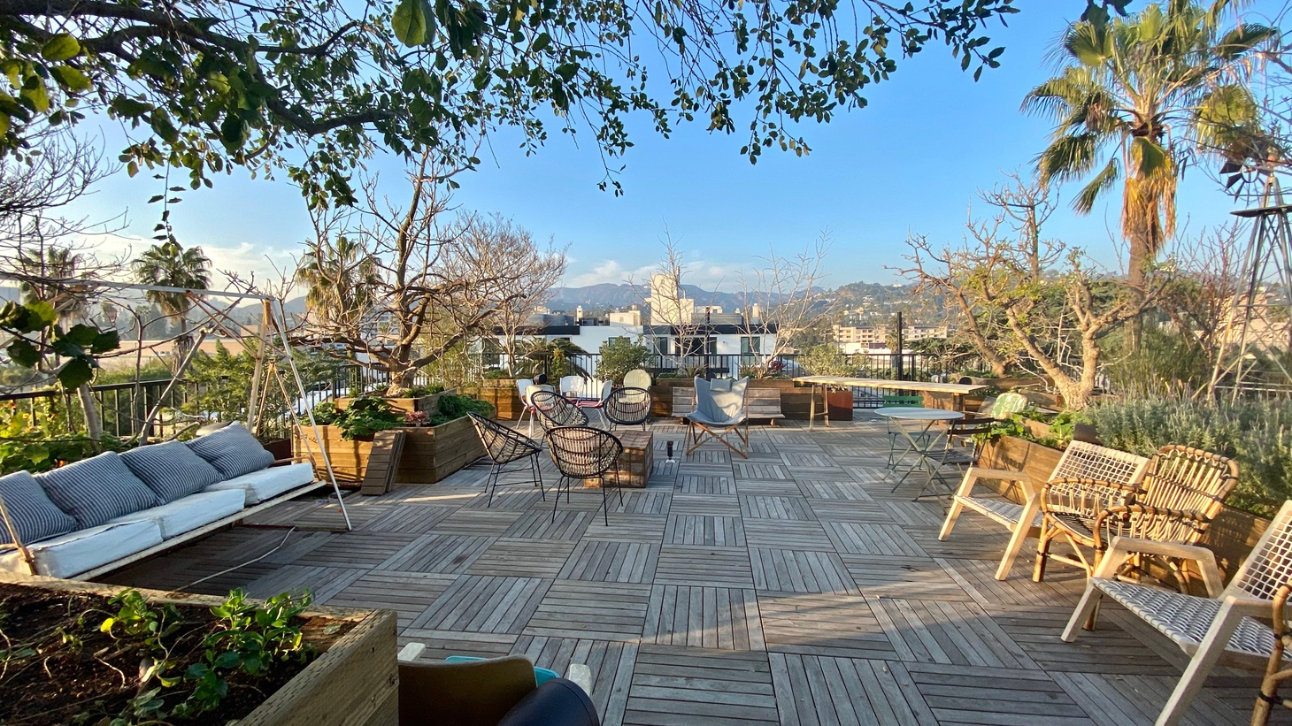 The rooftop at Treehouse, a co-living apartment building in Hollywood, features a cafeteria and is designed for group meals and socializing.