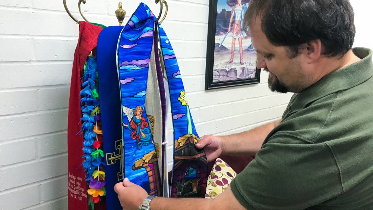 A collection of prayer shawls hang in the office of Pastor Brian Long in Yorba Linda, California. Long says he does not support same-sex marriage in the church. His congregants, however, are split over the issue.