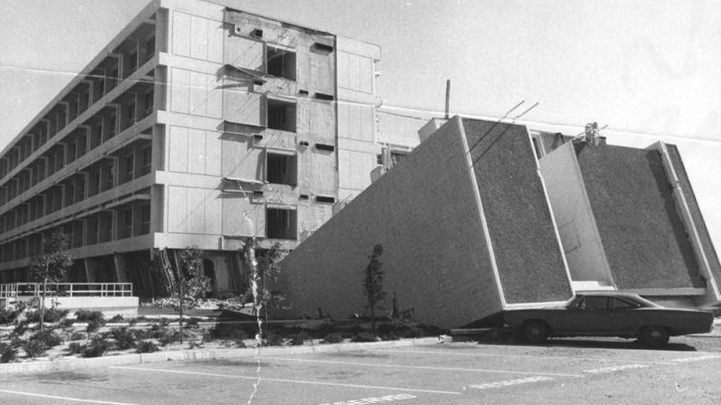 The north wing of Olive View Hospital was one of four wings to fall to the ground during the early morning of the Sylmar earthquake. It crushed the right front side of a car parked in the lot. Photo taken February 9, 1971.