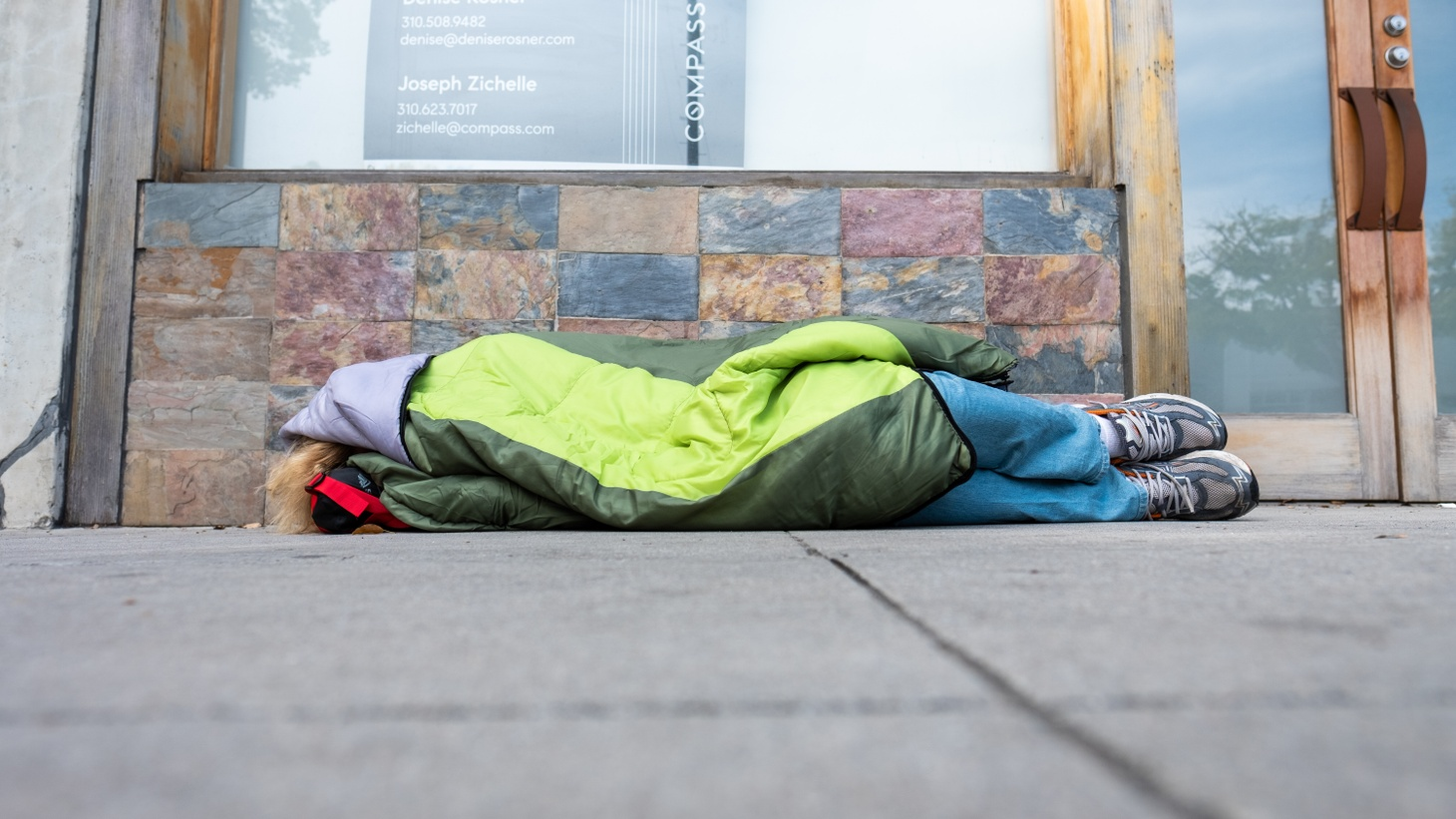 A person sleeping on Main St. in Culver City, March 2020. LA County's goal is to house 15,000 homeless people in hotel rooms during the coronavirus pandemic.