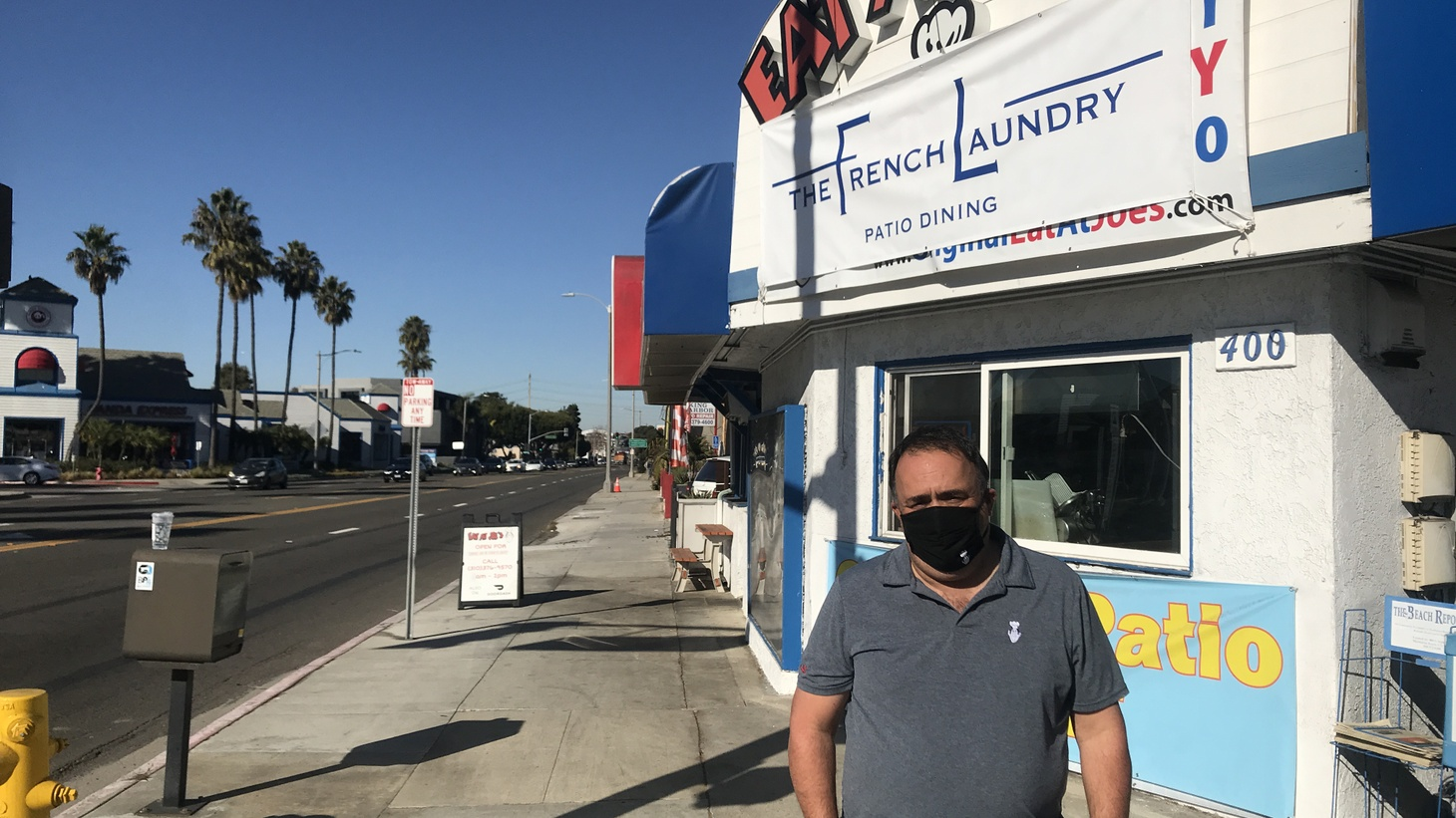 Alex Jordan stands outside his restaurant, Eat at Joe's, in Redondo Beach. His decision to drape a tarp advertising his diner as The French Laundry has ignited a fierce debate over a ban on outdoor dining in Los Angeles County.