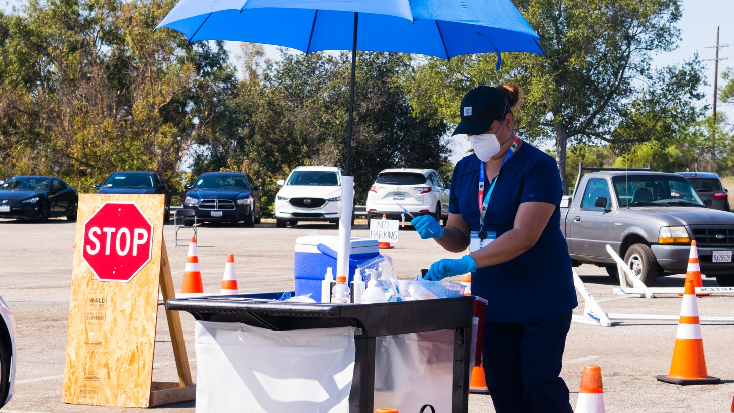 A health worker prepares a COVID vaccine shot at Dodger Stadium, a massive vaccination site in LA County, March 13, 2021. It's 25 miles from Hawaiian Gardens, but frequently it's the closest site with available appointments.