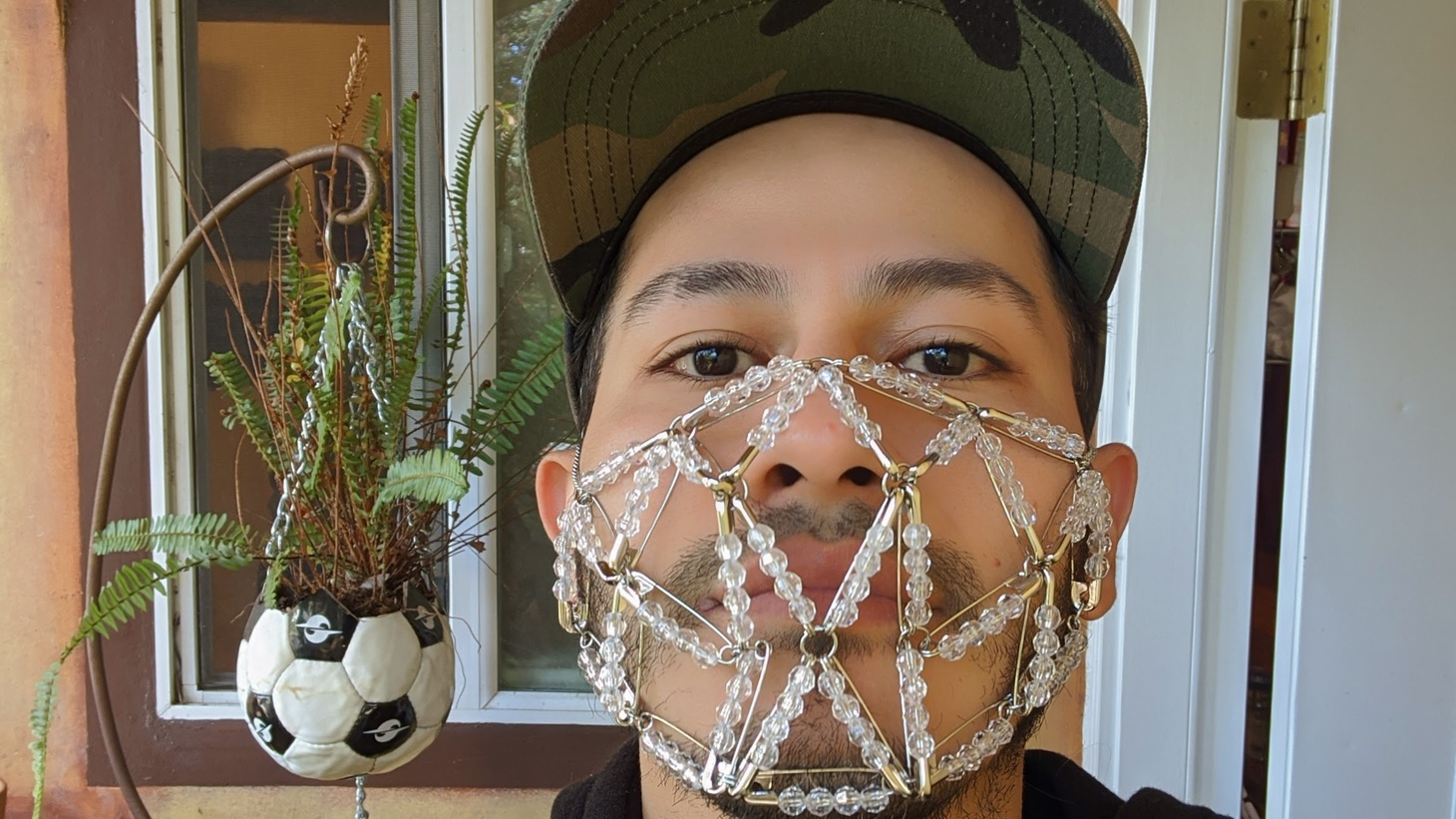 Fashion designer Rio Uribe wears the mask inspired by a dress from one of his collections.