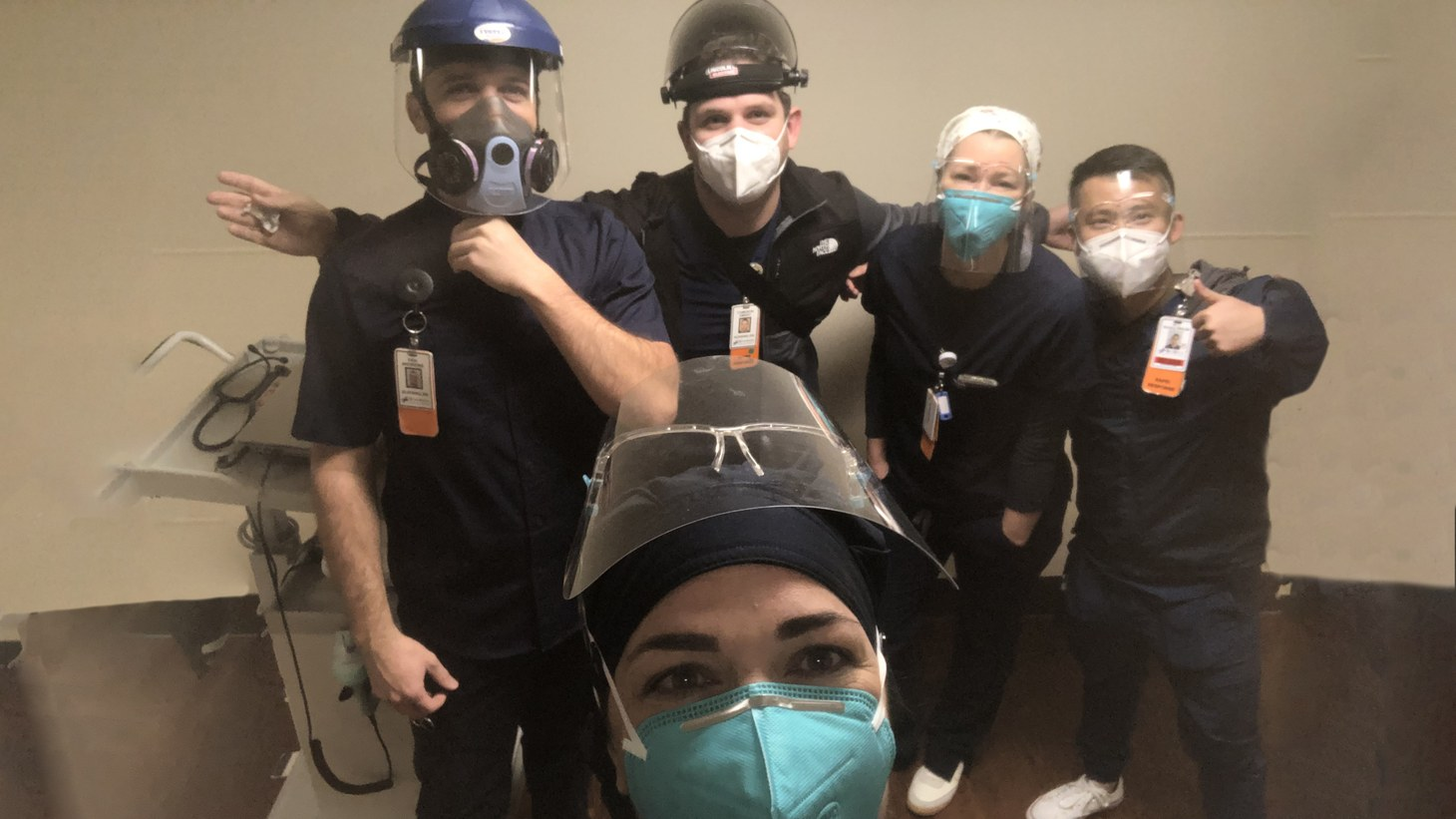 Erin McIntosh (front) poses with her colleagues at Riverside Community Hospital. Among the gear nurses regularly have to wear while treating COVID patients are face shields, N-95 masks, and respirators.