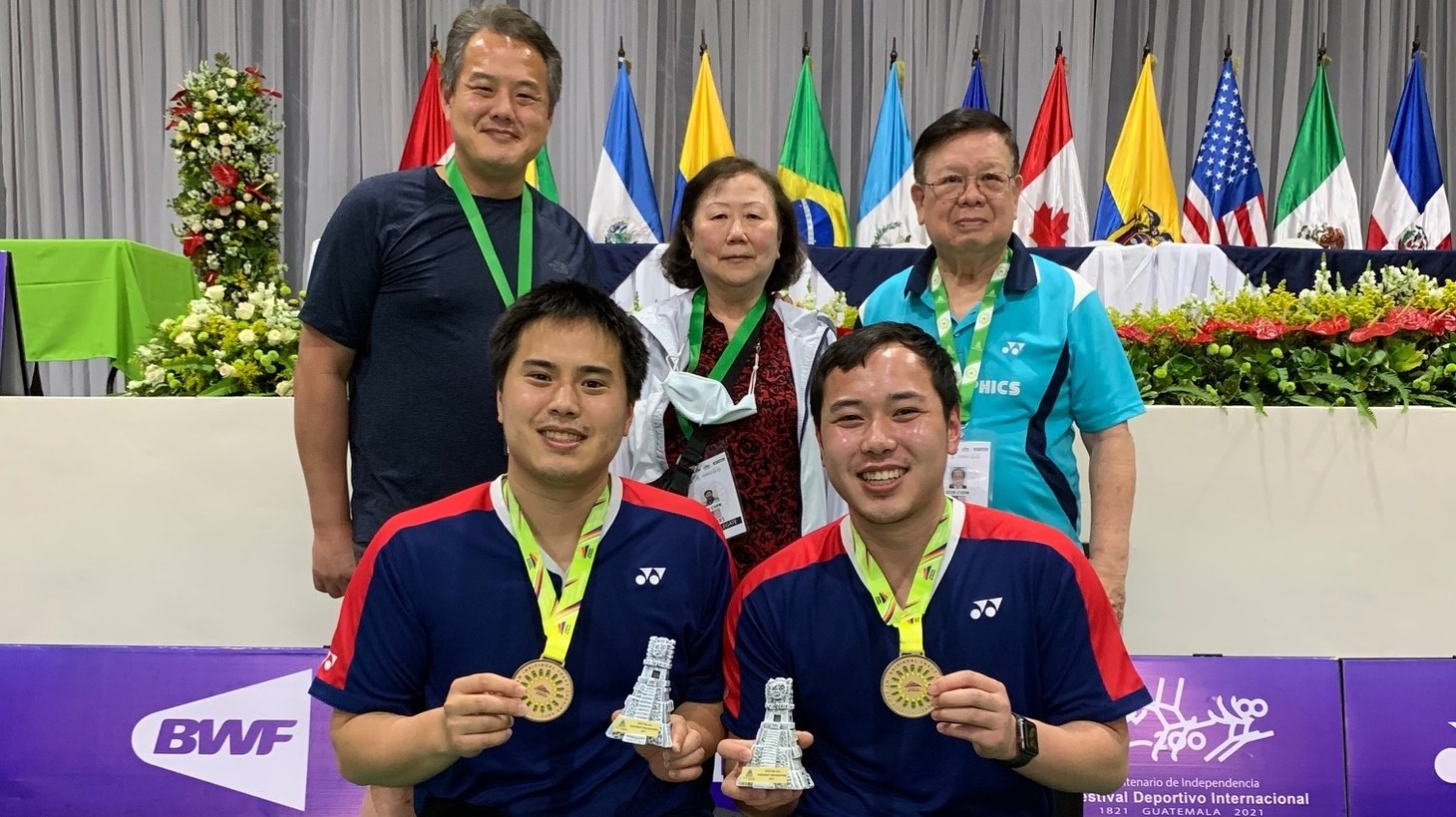 Phillip Chew (front left) and Ryan Chew (front right) with their family members after winning the 2021 Pan Am Championships.