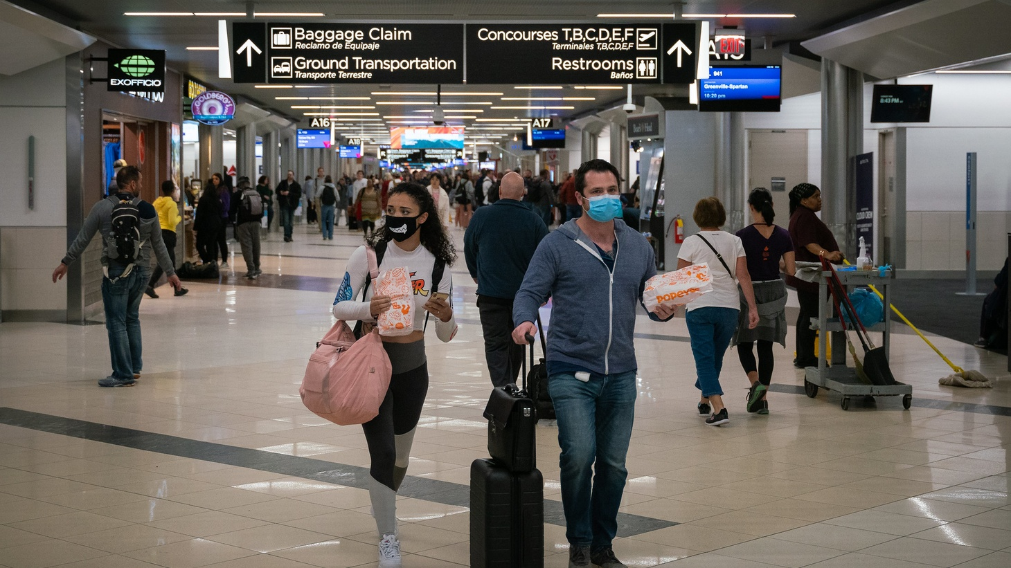 Flyers at Hartsfield-Jackson Atlanta International Airport wearing facemasks on March 6, 2020 as the COVID-19 coronavirus spreads throughout the United States.