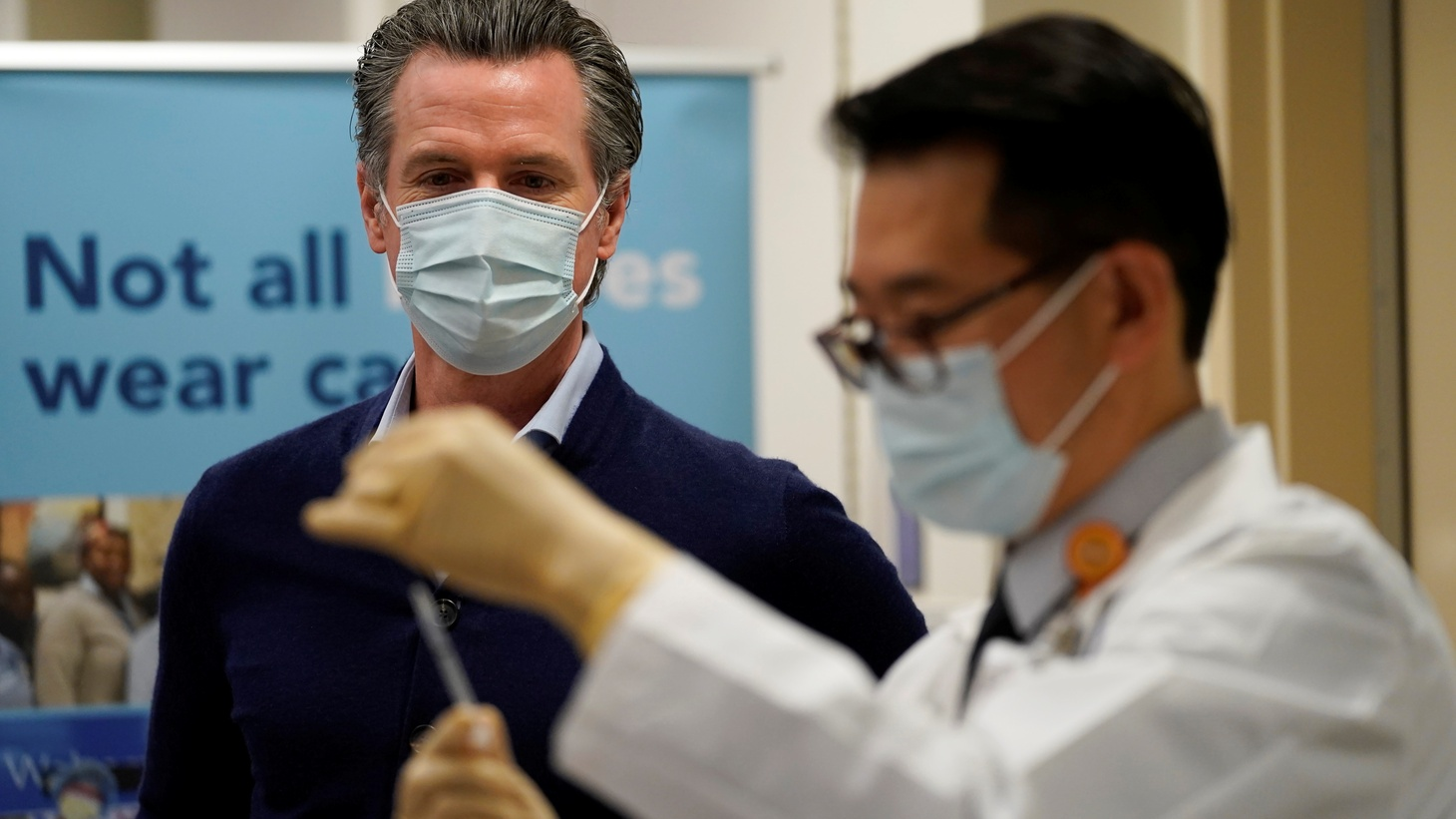 Gov. Gavin Newsom watches as the Pfizer-BioNTech COVID-19 vaccine is prepared by Director of Inpatient Pharmacy David Cheng at Kaiser Permanente Los Angeles Medical Center in Los Angeles, California, U.S. December 14, 2020.