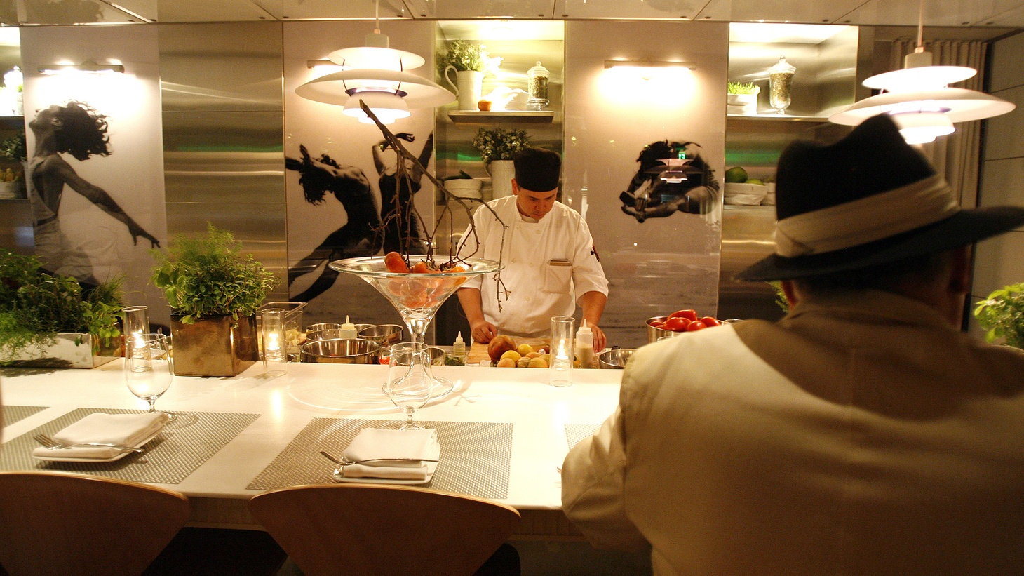 A patron sits at the bar of The Bazaar restaurant at the SLS hotel in Beverly Hills, California December 10, 2008. Spanish chef Jose Andres owns The Bazaar. But it shut down in August 2020 during the coronavirus pandemic.