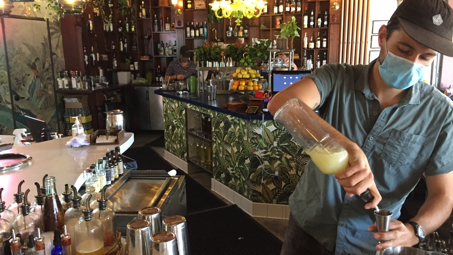 Bartender David Pecorari mixes up drinks at Shaker Mill in downtown Santa Barbara. The bar specializing in rum cocktails inspired by the Caribbean offered takeaway drinks as a way to make ends meet throughout the coronavirus lockdown.