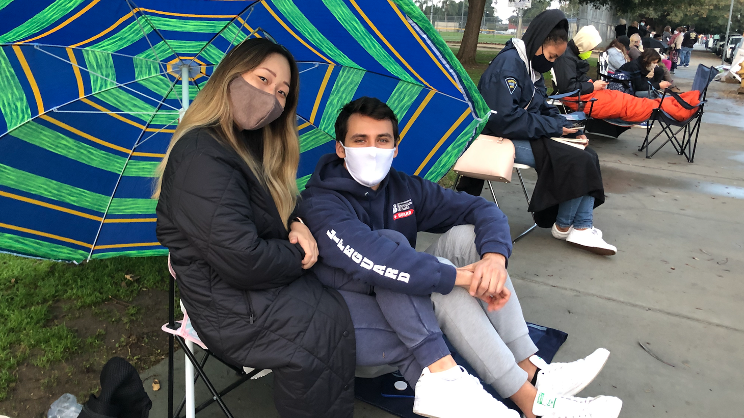 Stella Kim and James Cannon arrived at Kedren Community Health Center at 5 a.m. to potentially get leftover COVID vaccine shots at 4 p.m. Dozens of people were already waiting in front of them.