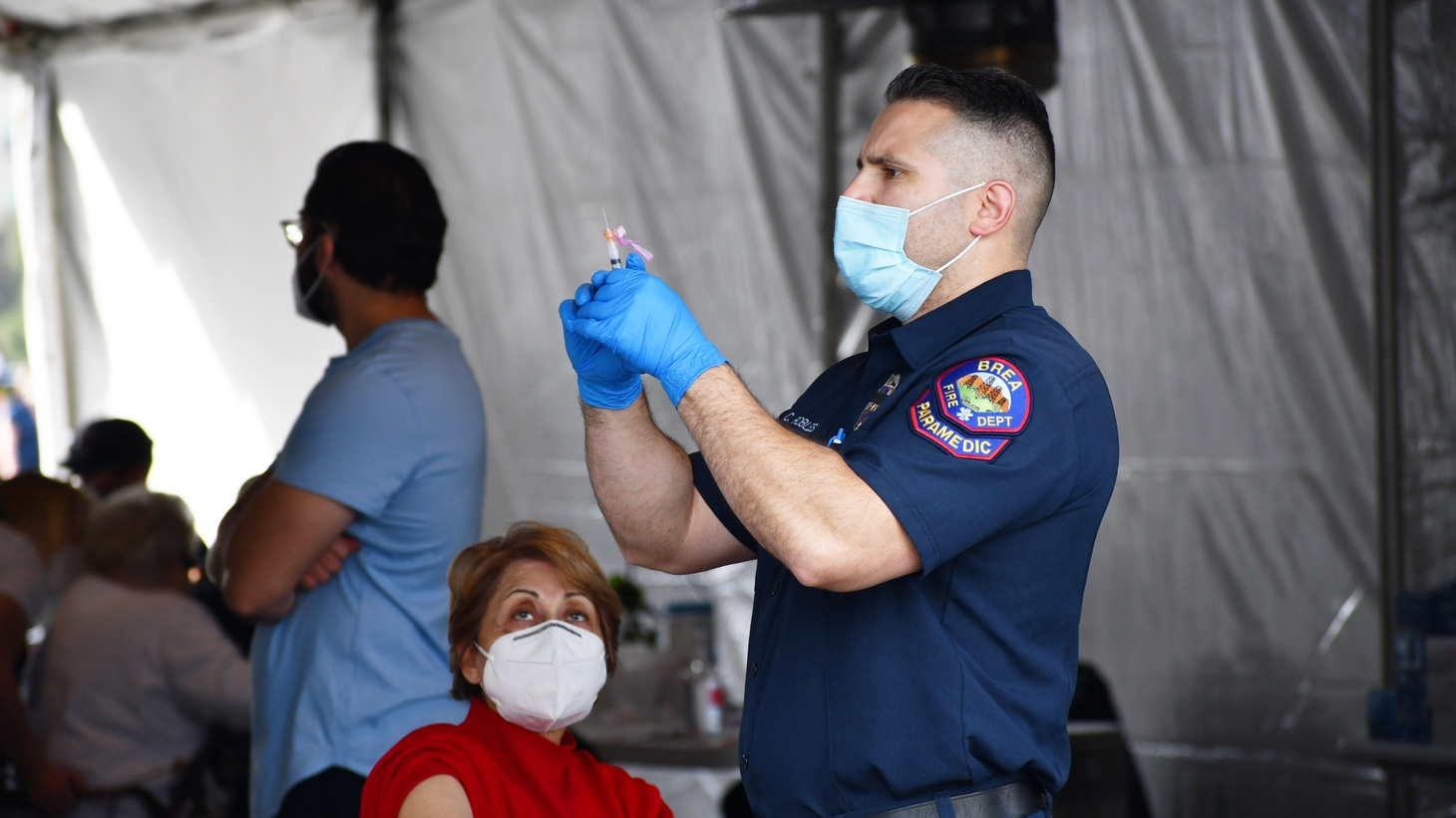 A health worker prepares a COVID-19 vaccine shot at Disneyland, which recently became a vaccination site. January 13, 2021.
