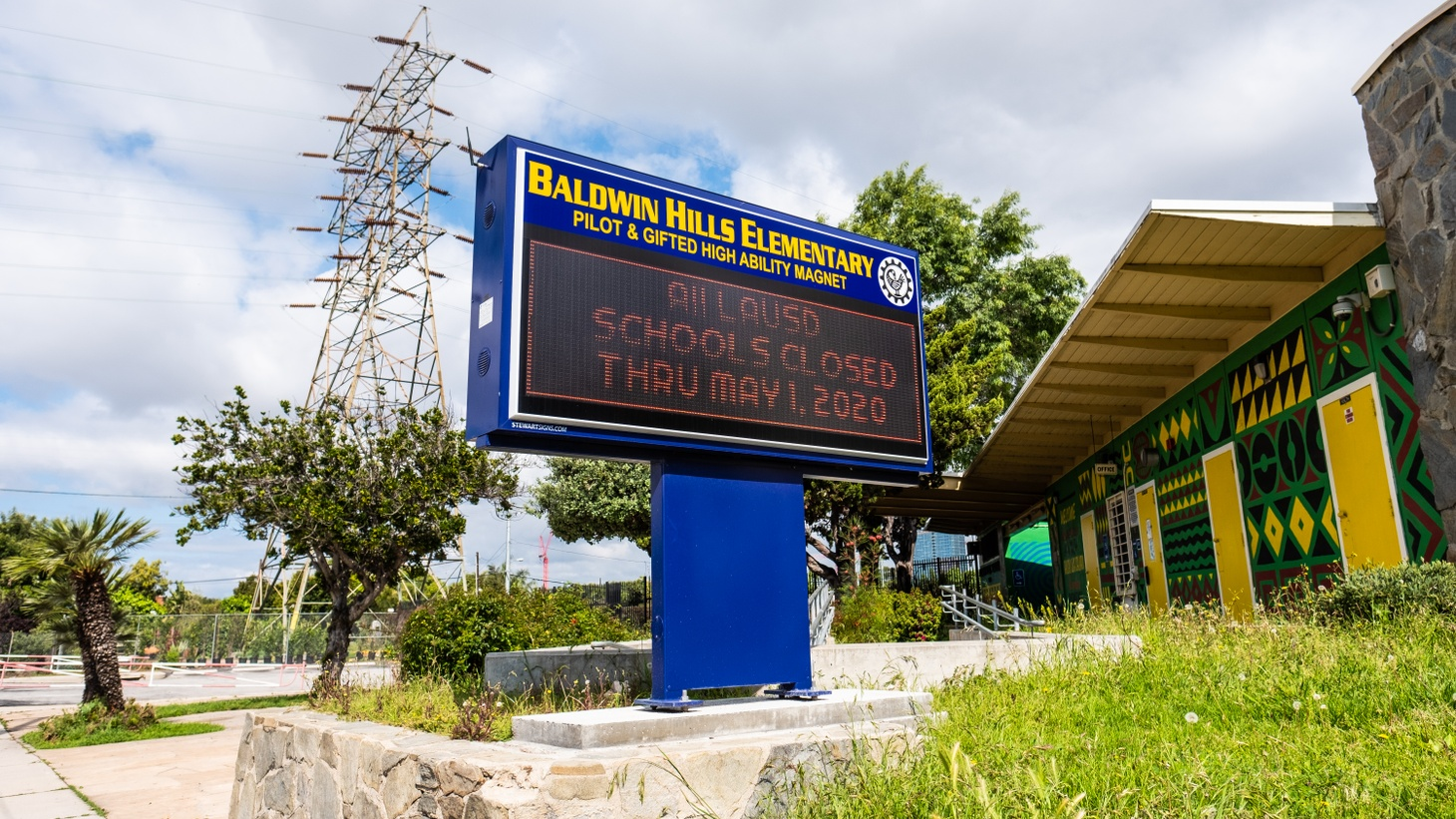 The sign outside Baldwin Hills Elementary School says all LAUSD schools are closed through May 1. This week, Governor Gavin Newsom indicated that students might return to classrooms in July.