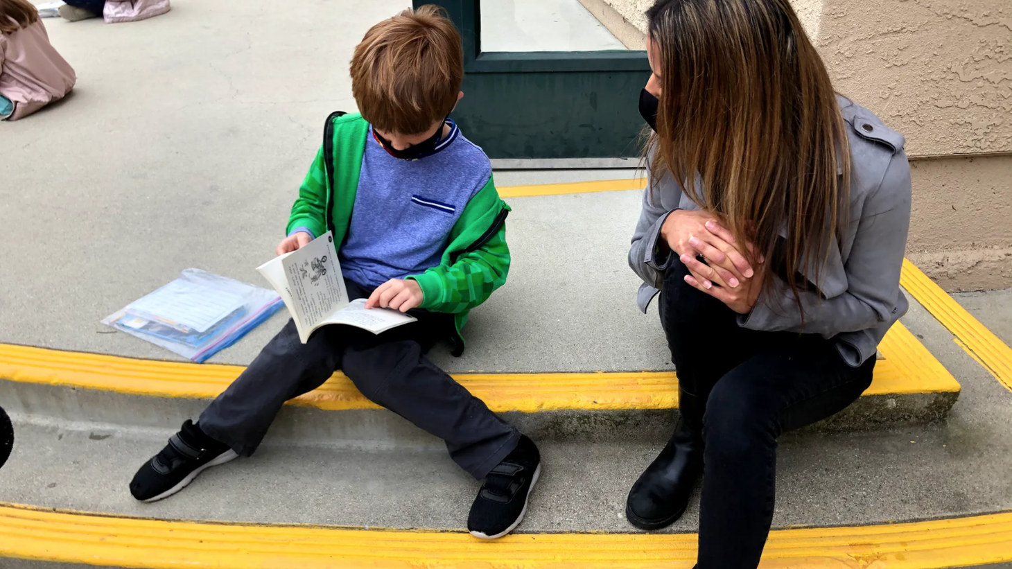 Second grade teacher Kari Share says her students love to read outside after a year of virtual instruction.