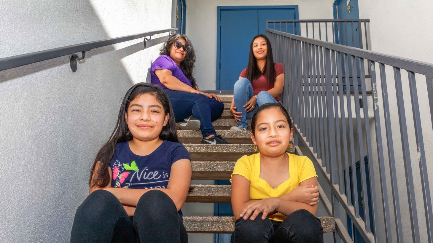 Mireya Pacheco (top left) and her three daughters, Mireyari, 17 (top right), Hossanna, 11, (bottom left) and Nefthali, 9 are beginning the new school year from their two-bedroom apartment in Pacoima. When the pandemic hit, dad lost work and the three girls started distance learning with a computer too outdated to run the programs they needed.