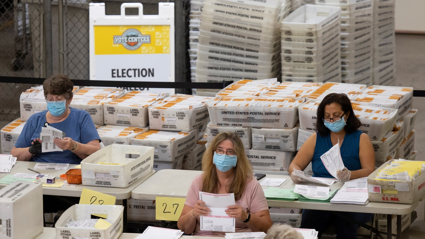 Election workers sort through some of the thousands of mail-in ballots at the Orange County Registrar of Voters in Santa Ana, California, U.S., November 2, 2020.