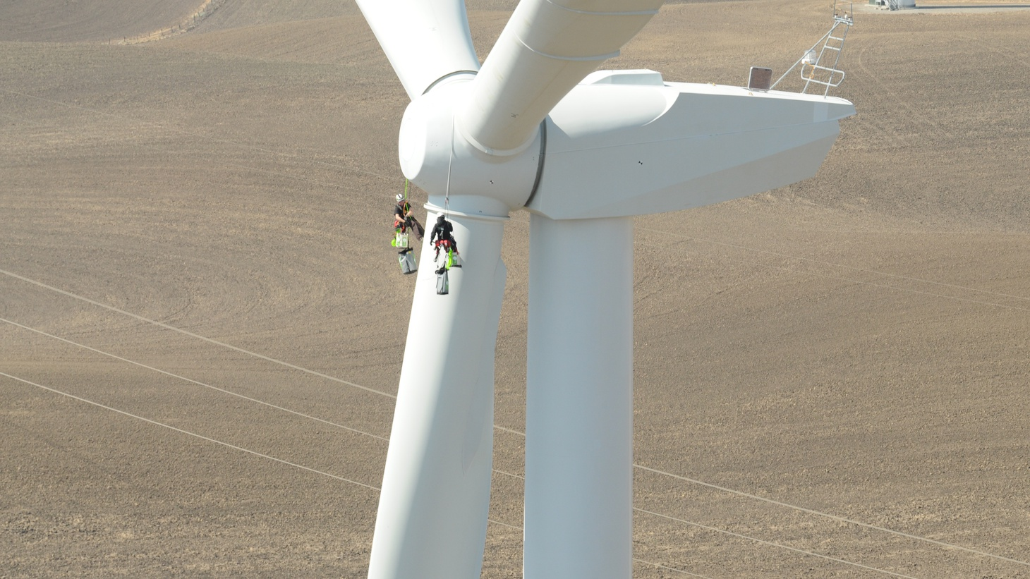 Climbers service a turbine blade at Shiloh Wind power plant in the Montezuma Hills of Solano County.