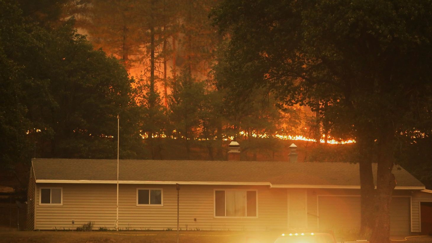 A house is surrounded by the Dixie Fire near Greenville, California, U.S., August 10, 2021.