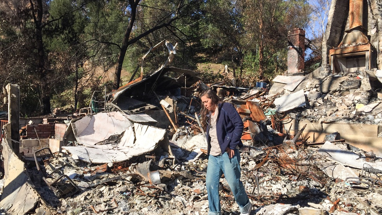 Mai Lindquist amidst the rubble after the Woolsey Fire.
