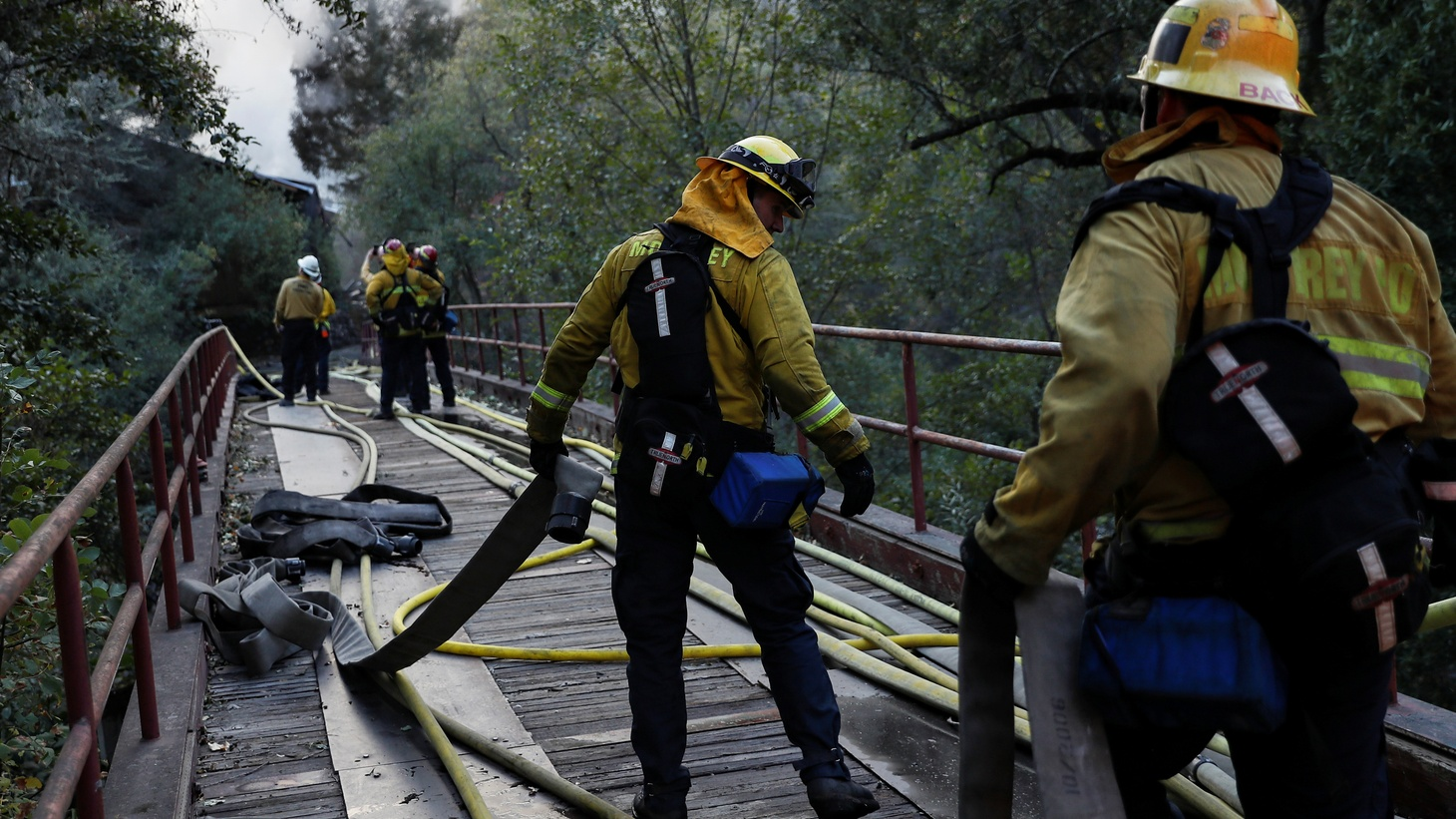 A firefighter works with a hose while working on a burning structure during the Kincade fire in Calistoga, California, U.S. October 29, 2019.
