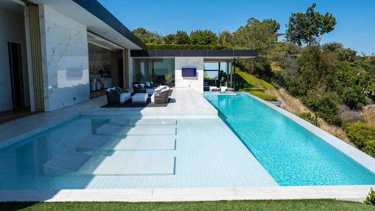 """The house has a name: """"Opus."""" It sits in the Trousdale Estates section of Beverly Hills, on a cul-de-sac that realtors refer to as """"billionaire's elbow."""""""