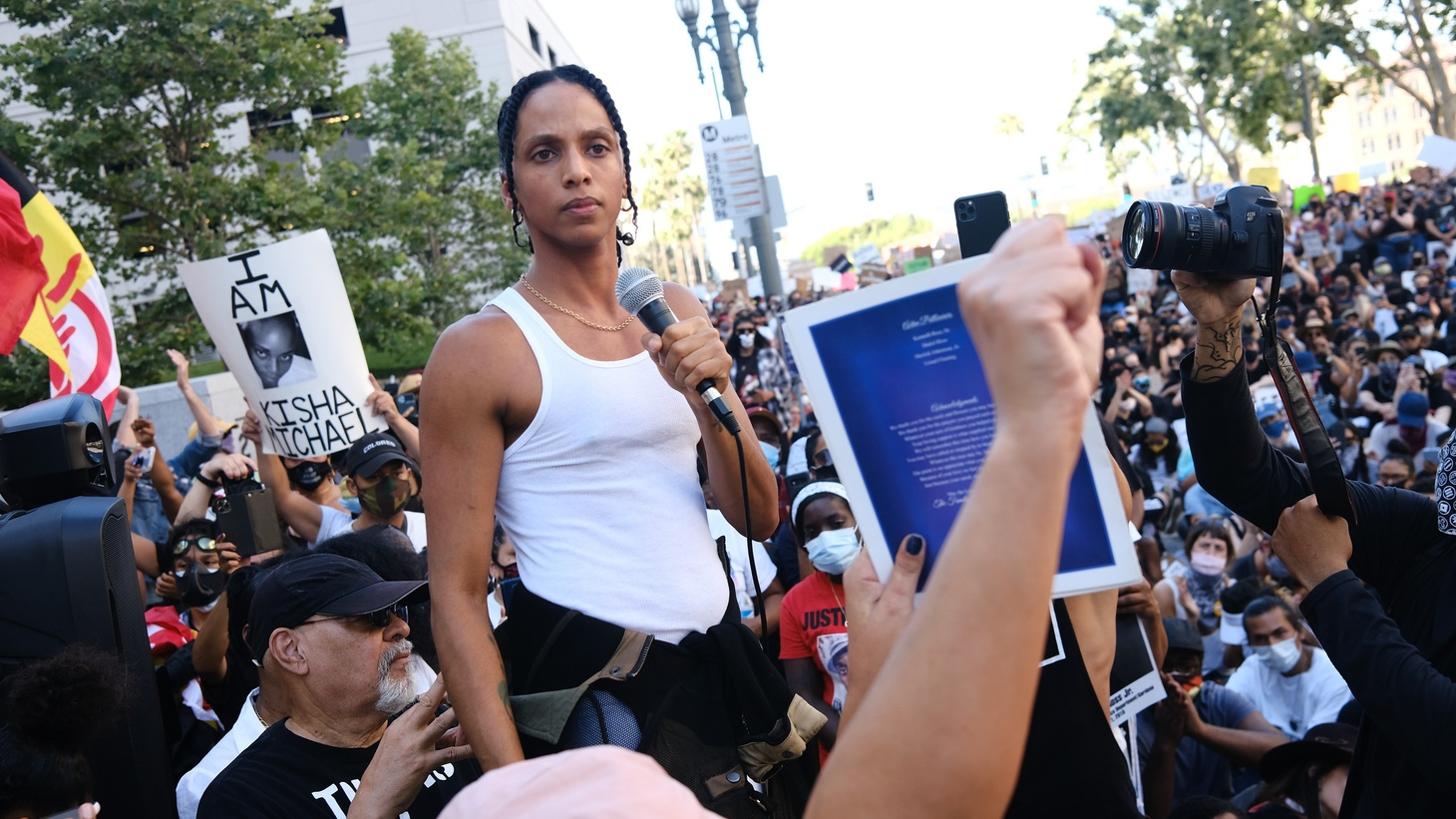 An activist speaks to demonstrators organized by Black Lives Matter LA. The rally was in front of the Los Angeles County Hall of Justice to protest District Attorney Jackie Lacey. About 10,000 Angelenos protested police violence, the proposed LA city budget, and the death of George Floyd. June 3, 2020.