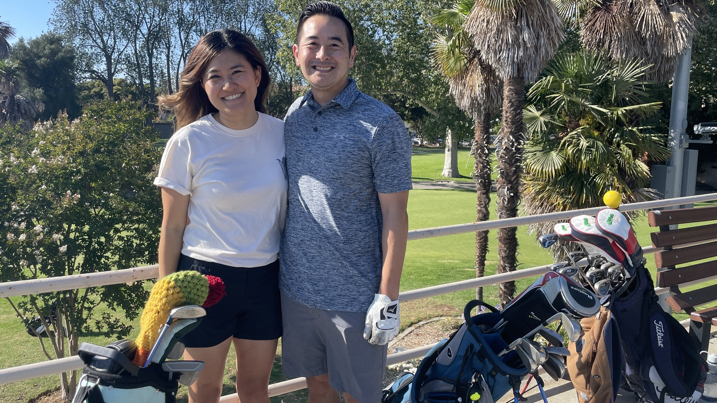 Jessica Youn and her husband, Scott Iseri, at the Rancho Park Golf Course driving range.