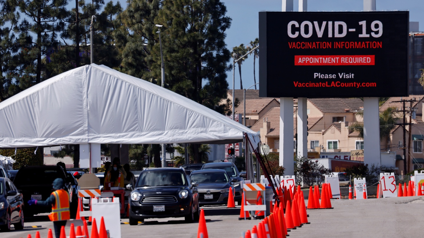 Cars line up in this drive-thru vaccination site during the outbreak of the coronavirus disease (COVID-19) in Inglewood, California, U.S., March 15, 2021.