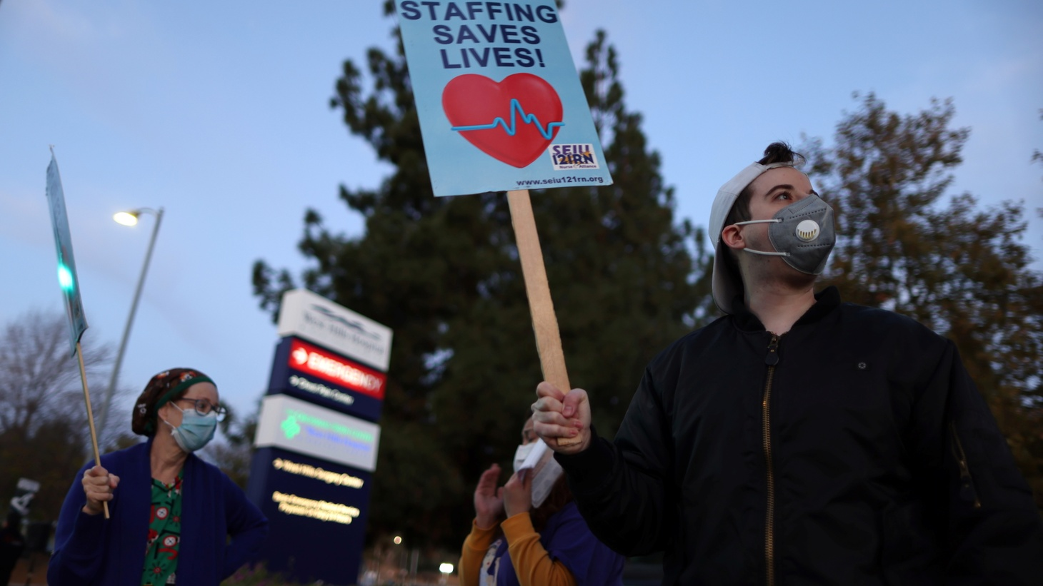 People attend a protest for nurses demanding more PPE, coronavirus testing, and staff, as the outbreak of the coronavirus disease (COVID-19) continues, in West Hills, Los Angeles, California, U.S., November 30, 2020.