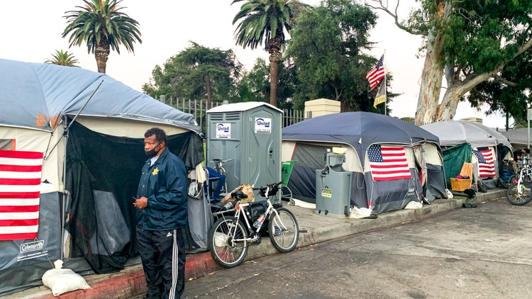 On one of the lawns at the West LA VA, there are rows of camping tents for veterans experiencing homelessness. It's an alternative to sleeping on the sidewalk.