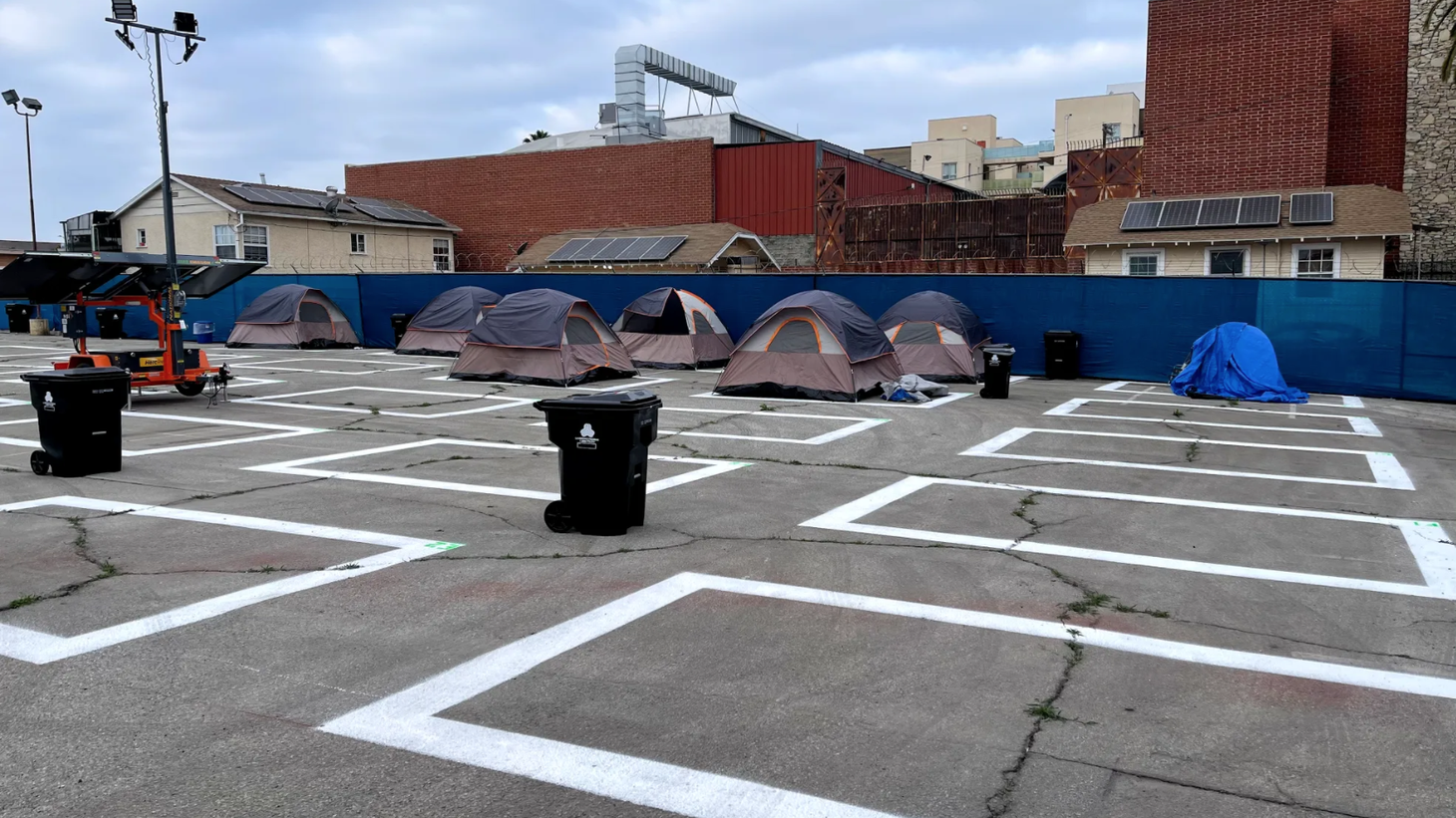 This parking lot on Madison Avenue, off Beverly Boulevard, has been turned into a government-sanctioned homeless encampment that can accommodate about 120 people at a time in 12-foot by 12-foot spots.
